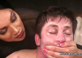Tranny bangs mouth and ass to guy in bondage