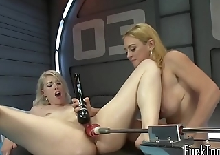 Pretty lesbian orgasms during machine time
