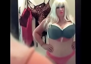 Bimbo doll surrounding mirror