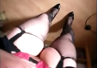 Big Legs in fishnet on heels.