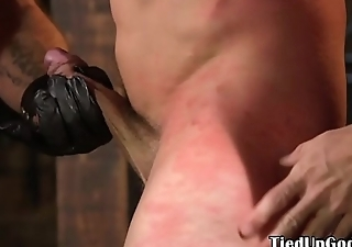 BDSM sub roughly flogged by dominant hunks