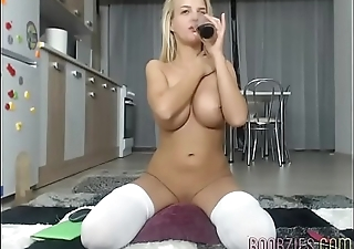 a hot college girl fucks her shaved pussy on camera